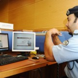 A policeman interacting with deaf person via the system.
