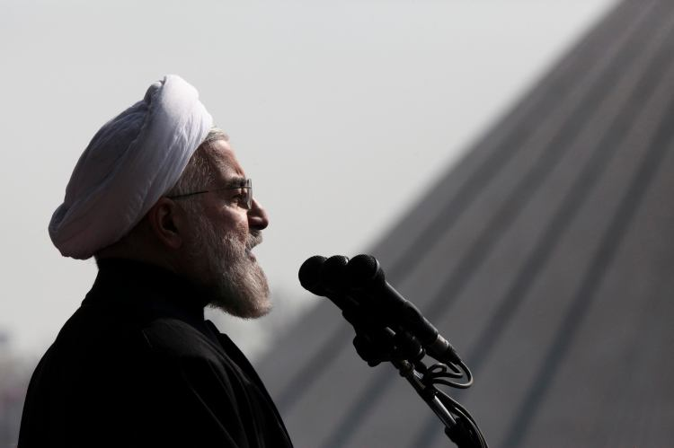 Iranian President Hassan Rouhani, delivers a speech during an annual rally commemorating anniversary of the 1979 Islamic revolution, at the Azadi 'Freedom' Square in Tehran, Iran, Feb. 11, 2014. (AP Photo/Vahid Salemi)