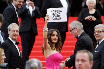 "Actress Salma Hayek holds up a sign reading ""bring back our girls"", part of a campaign calling for the release of nearly 300 abducted Nigerian schoolgirls being held by Nigerian Islamic extremist group Boko Haram. Cannes, May 17, 2014. Photo credit: AP Photo/Thibault Camus, File"