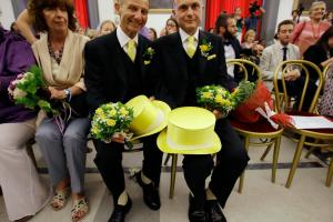 Angelo Albanesi, left, and Pier Giorgio De Simone wait for their civil union being registered by a municipality officer during a ceremony in Rome's Campidoglio Capitol Hill, Thursday, May 21, 2015. Rome's municipality registered some of 20 couples after the Capitol Hill assembly deliberated Jan. 2015, the creation of a civil unions' single register. (AP Photo/Gregorio Borgia)