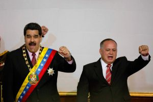 Venezuela's President Nicolas Maduro, left, and National Assembly President Diosdado Cabello gesture with their fists during a session at the National Assembly in Caracas, July 6, 2015.  (AP Photo/Ariana Cubillos)