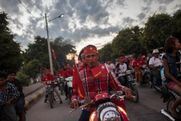 Supporters of Myanmar's opposition leader Aung San Suu Kyi's National League for Democracy (NLD) party campaign on motorbikes for the general election in Mandalay, Myanmar, Nov. 5, 2015. (AP Photo/Hkun Lat)