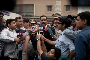An Indian lawyer, center, addresses the media at the Tis Hazari Courts premises, in New Delhi, India, Nov. 3, 2015. (AP Photo /Tsering Topgyal)