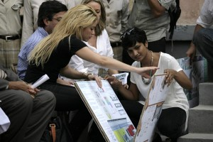 Colombian singer Shakira watches the development project by Sadhya Janardham, worker of the NGO Architecture for Humanity, during her visit to Elie Dubois school in downtown Port-au-Prince, Haiti, on March 31, 2011.   (EPA/Andres MartÌnez Casares)