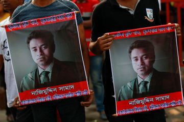 People carry portraits of student activist Nazimuddin Samad as they attend a rally to demand arrest of three motorcycle-riding assailants who hacked and shot Samad to death, in Dhaka, Bangladesh, Friday, April 8, 2016. Police suspect 28-year-old Samad was targeted for his outspoken atheism in the Muslim majority country and for supporting a 2013 movement demanding capital punishment for war crimes involving the country's independence war against Pakistan in 1971. (AP Photo)