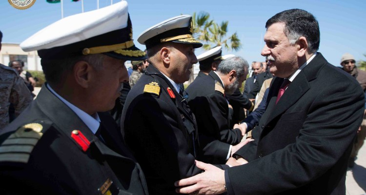 Fayez Serraj, right, of the U.N.-brokered Libyan unity government on arrival in Tripoli, Libya. He arrived by sea with six deputies to set up a temporary seat of power in a naval base despite threats from competing factions, March 30, 2016 (Media office of the Unity Government / GNA Media via AP)