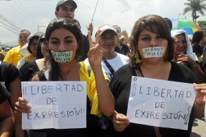 "Journalists and protesters march with their mouths taped shut that read in Spanish ""If I speak I die"" and hold signs that read ""Freedom of expression!"" as they protest violence against members of the media in the capital city of Tegucigalpa, Honduras, Friday, May 25, 2012.  Journalists protested the murder of Honduran radio journalist Angel Alfredo Villatoro just last week and other recent attacks on the local media. According to the Committee to Protect Journalists, CPJ, Honduras is one of the most dangerous countries in the region for journalists. (AP Photo/Fernando Antonio)"