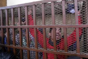 Egyptian defendants react after the court cleared 26 men who had been accused of homosexual activity, at a courthouse in Cairo, Egypt, Jan. 12, 2015.  (EPA/Khaled El-Fiqi)