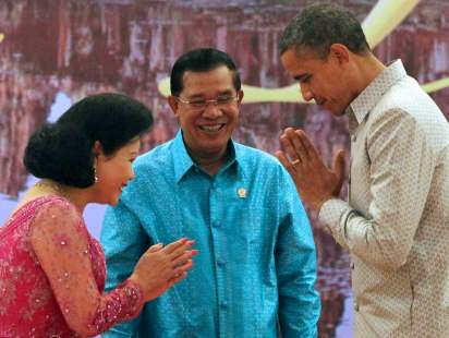 Obama with Cambodian Prime Minister Hun Sen and his wife Bun Rany in Phnom Penh in 2012. (AP Photo/Apichart Weerawong)