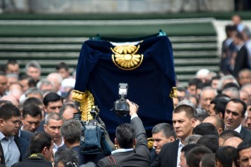A coffin with the body of Uzbek President Islam Karimov is carried during his funeral ceremony in Samarkand, Uzbekistan, Sept. 3, 2016. Karimov who crushed all opposition in the Central Asian country  as its only president in a quarter-century of independence from the Soviet Union, has died of a stroke at age 78. (AP Photo)