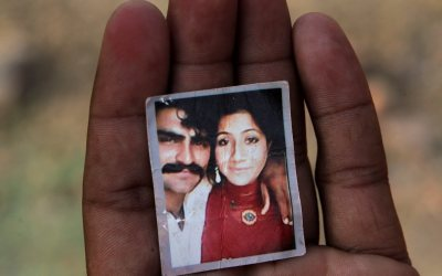 "Mohammed Tofeeq dispalys a picture of himself with his wife Muqadas Tofeeq, who local police say was killed by her mother, at his home in Butrawala village on the outskirts of Gujranwala, Pakistan, Saturday, June 18, 2016. Police in Pakistan say they have arrested the mother of Muqadas Tofeeq who is accused of killing her pregnant daughter for marrying against the wishes of her family. Violence against women is not uncommon in Pakistan where nearly 1,000 women are killed each year in so-called ""honor killings"" for violating conservative norms on love and marriage. (AP Photo/K.M. Chaudary)"