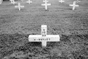 Grave markers give the date of execution and prisoner numbers at a cemetery in Texas.