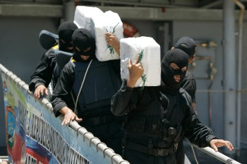 Venezuelan navy police officers carry packages of seized cocaine to be shown to at a press conference in Punto Fijo, Venezuela in 2009. (AP Photo/Ariana Cubillos)