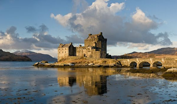 Eilean Donan Castle, as viewed from the south-east at sunrise. Photo by DAVID ILIFF. License: CC-BY-SA 3.0