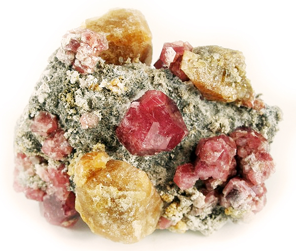 A beautiful, 1.4 cm, translucent, raspberry-red, compound grossular garnet is very aesthetically set on the matrix plate and is surrounded by smaller garnets and lustrous, translucent, tannish-yellow vesuvianite crystals on this fine piece from the mid-1990s finds at the well-known Lake Jaco deposit of Mexico. Classic combination material from the Robert Whitmore Collection # 3832.