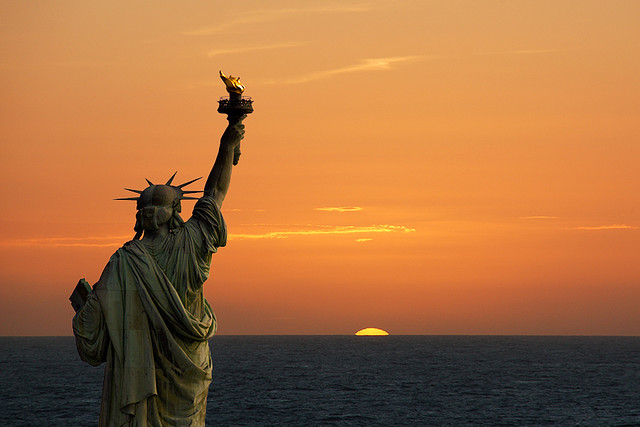 Symbols statue of liberty sunrise