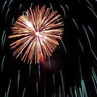 Massachusetts Fireworks: golden burst and falling green tendrils