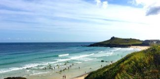 St. Ives's surf school on a summer Saturday morning at Porthmeor Beach, St. Ives, Cornwall