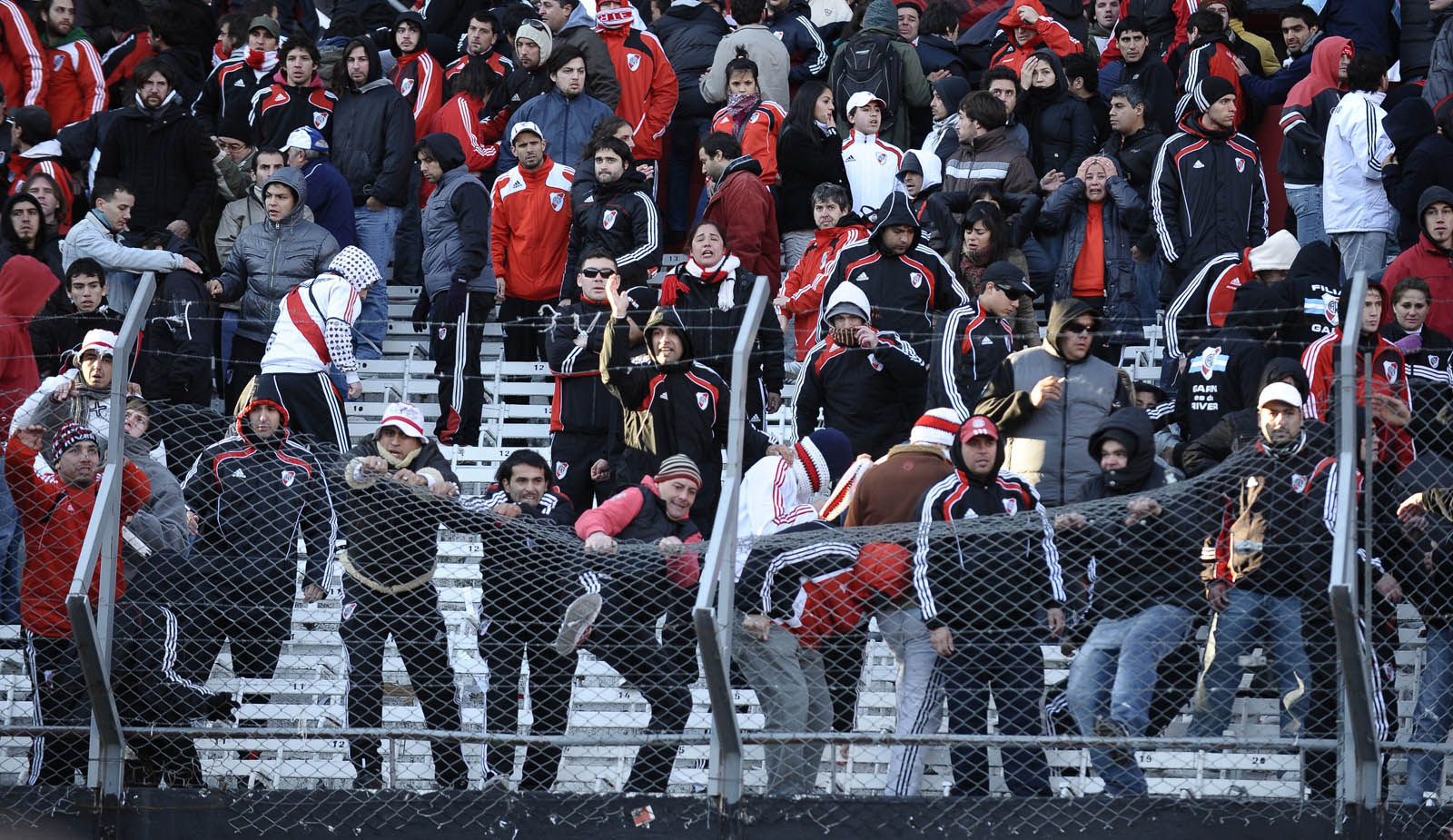 Supporters of River Plate react after the team was relegated to second division after the Argentina's Promotion football match against Belgrano, at Monumental stadium in Buenos Aires, on June 26, 2011. Argentine giants River Plate has been relegated to second division for the first time in its history after being beaten 2-0 by Belgrano in the first leg of their play-off on Wednesday and tying 1-1 in the second leg match today. On the other hand Belgrano will play in first division next season. AFP PHOTO/Alejandro PAGNI (Photo credit should read ALEJANDRO PAGNI/AFP/Getty Images)