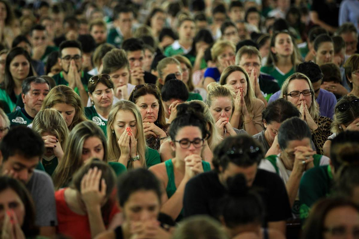 Thousands squeezed into Chapeco's cathedral and even more packed a stadium to mourn the death of 71 people in a plane crash, 19 of them members of the Chapecoense club who had been on the brink of football greatness.