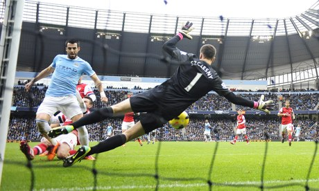 Alvaro Negredo scores the second goal for Manchester City against Arsenal in the Premier League