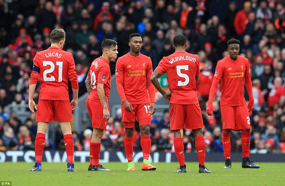 The Liverpool players show their frustration on the pitch as they face up to a shock fourth round FA Cup exit to Wolves.