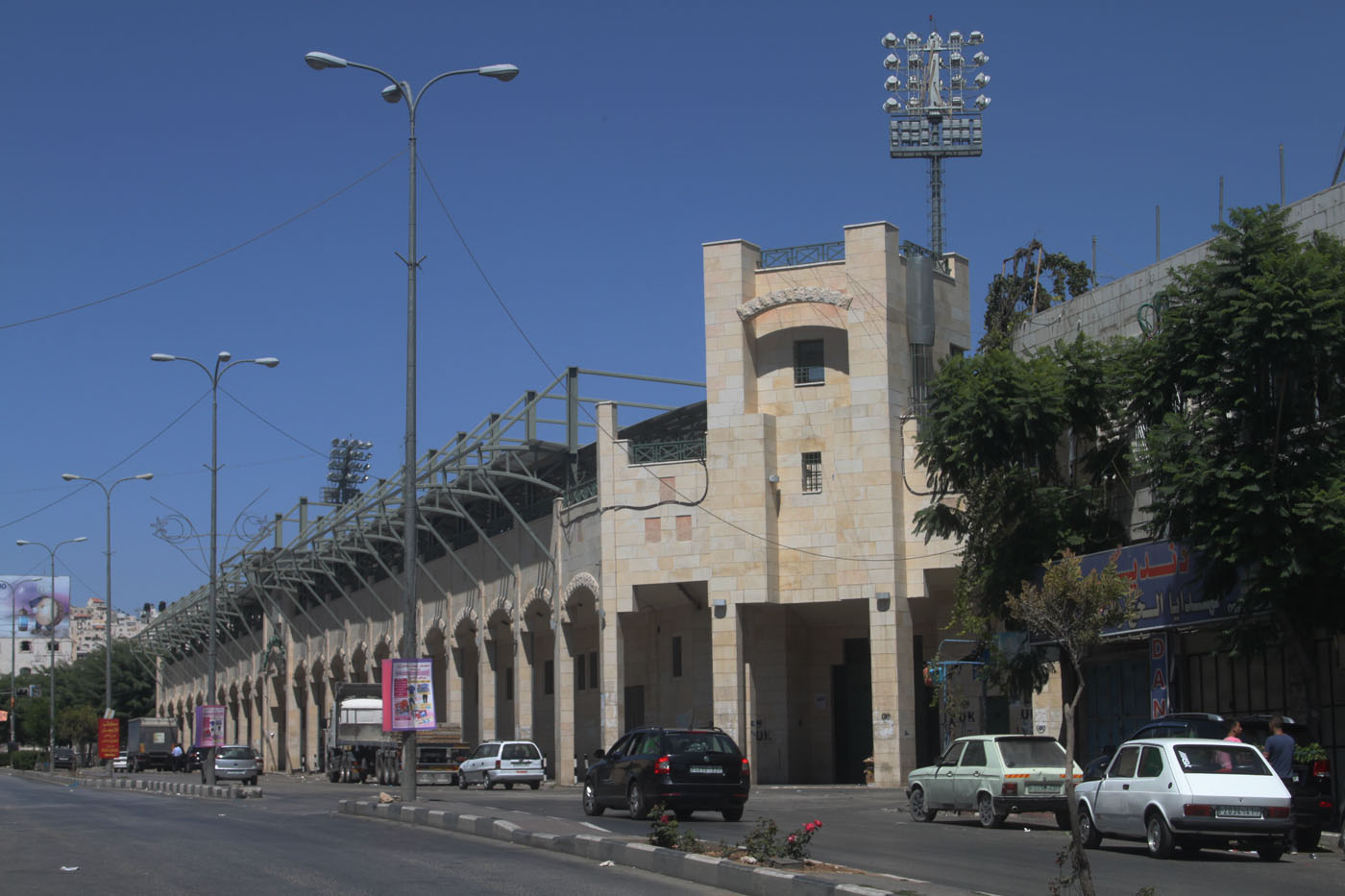 Hussein Bin Ali Stadium Just outside of Hebron city centre you will find Hussein Bin Ali Stadium. Home of at least five football clubs. The lack of space and water in West Bank means you can't play football just anywhere.