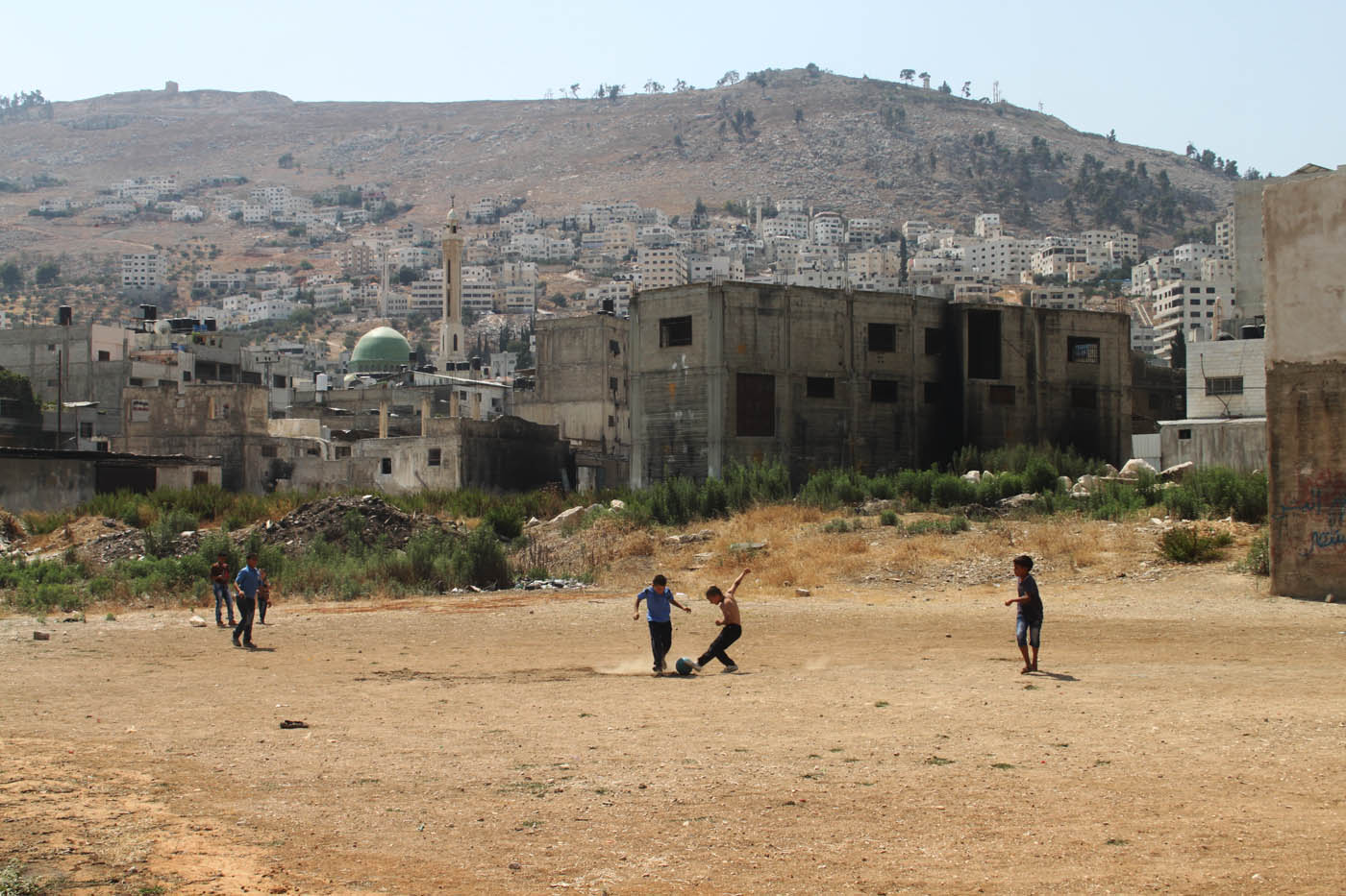 West Bank is among top 20 most populated places in the world. Distances between houses in Balata refugee camp are not more than 1.5 meters in average and it is difficult to find space to live let alone to play football. Yet, what do kids know what is 1.5 meters?