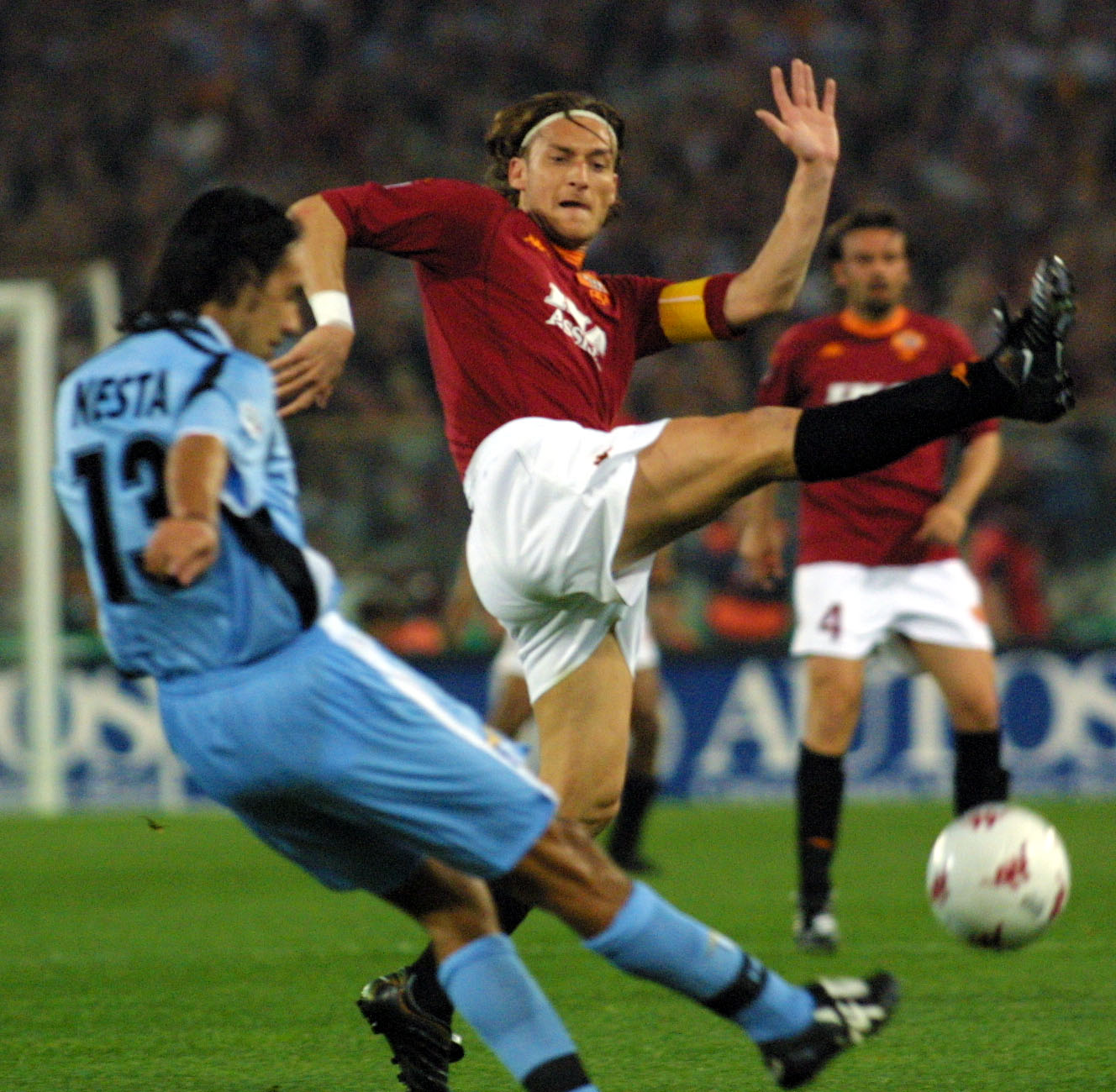 ROME, ITALY: Lazio Rome captain Alesandro Nesta (G) figths for the ball with AS Roma captain Francesco Totti during their Italian first league derby game, at the Rome's Olympic Stadium, 29 April 2001. AFP PHOTO GABRIEL BOUYS (Photo credit should read GABRIEL BOUYS/AFP/Getty Images)