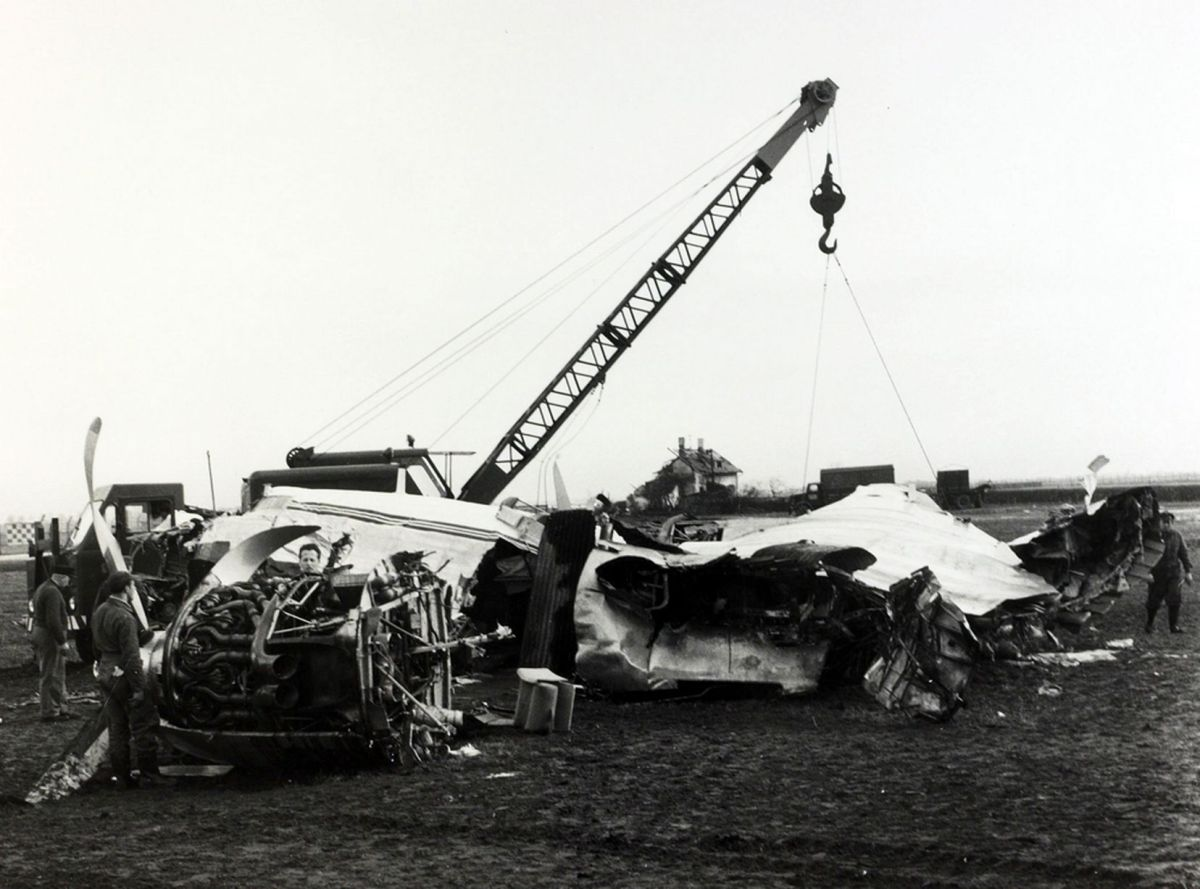 "The wreckage of the B,E,A, Elizabethan airliner G-ALZU ""Lord Burghley"" after the crash at Munich in which 23 people died, 8 being Manchester United footballers, about to be removed with the help of a crane (Photo: Getty)"