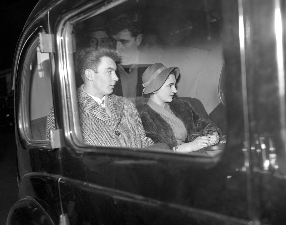 Manchester United Outside right Ken Morgans pictured with his fiancee Stephanie Lloyd driving away from Liverpool Street Station after returning from Munich.