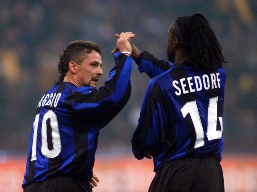 Inter's Roberto Baggio celebrates with Dutch teammate Clarence Seedorf after scoring during the Inter vs Milan Italy Cup quarterfinals second leg match at the San Siro stadium in Milan, Italy, Thursday, January 27, 2000. (AP Photo/Luca Bruno)