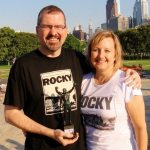 Atop the Rocky steps with small statue web