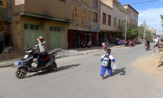 kashgar street boy running