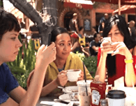 everyone on cell phone cellphone except one person at a meal dinner lunch