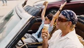 Bill Murray and Jaeden Lieberher eat ice cream after winning a bet on a horse race in St. Vincent.