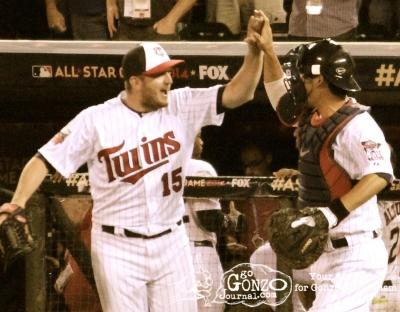 Minnesota Twins Glen Perkins and Kurt Suzuki celebrate winning the 2014 MLB All-Star Game at Target Field in Minneapolis