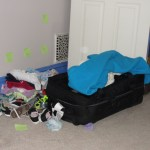 Note the Post-its on the wall - they were to ensure we knew what piles of kids clothes were for what