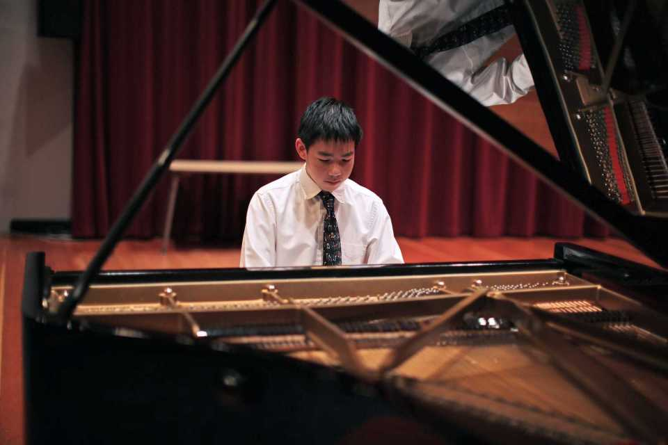 Alex Chien, one of the winners of the San Francisco Young Pianist Competition, warms up before a performance in Knuth Hall on Sept 6. Photo by John Ornelas / Xpress