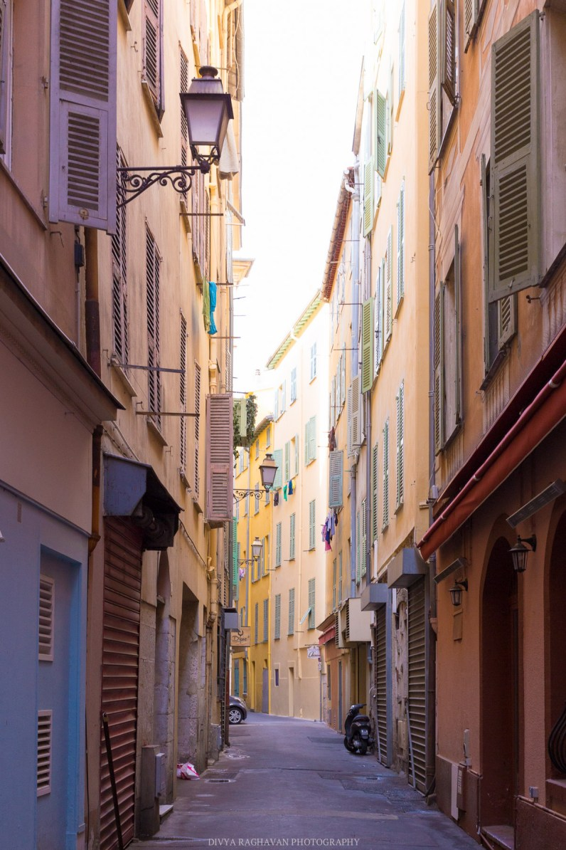 Early mornings in cobblestone alleys of the old town of Nice, South of France