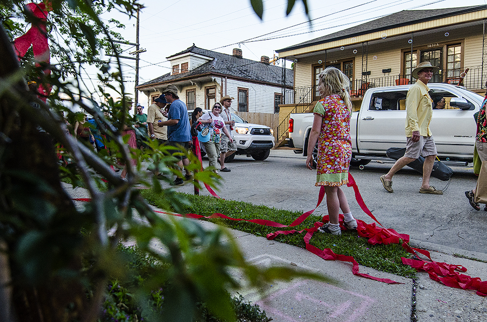 April 22, 2016 - New Orleans, LA: Even the youngest of festival goes delight in the street parties that take place following the New Orleans Jazz and Heritage Festival, including at The Bubble House, the first residence festival goers pass when exiting onto Mystery Street. The Bubble House is exactly what it sounds like, a house full of partiers that emits a constant stream of bubbles, each year with a different theme. This year's theme is Summer Camp. (Photo by Katie Sikora)