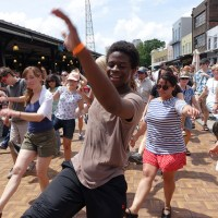 """Add the swing dance lessons (with live hot jazz) daily in the French Market during French Quarter Fest to your """"must see"""" list. And bring your dancing shoes and join in the fun! (Photo: Paul Broussard)"""