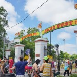 The gates on Gentilly Blvd. welcome you to Jazz Fest. (Photo: Paul Broussard)