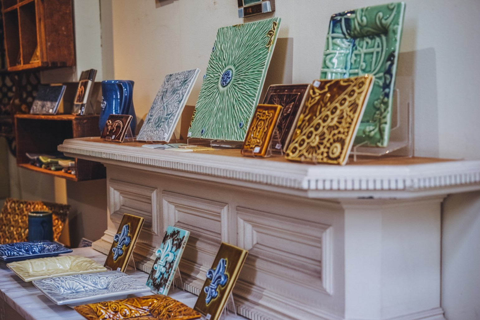 I've been collecting and giving gifts of tiles, plates and bowls and other decorative pieces from Derby Pottery for years. You can watch Mark work in his studio, and even see the original items from which his designs are based off of, showing the real color and craft that many Magazine Street merchants possess.