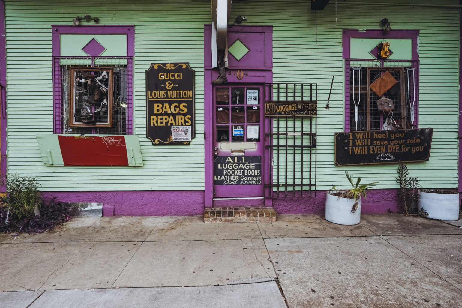 I love the signs and colors of this bag and shoe repair shop next door to one of my favorite restaurants on the street (Baru Tapas - 3700 Magazine St.)
