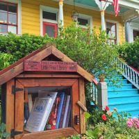 A Little Free Library outside a colorful home. (Photo: Emery Finegan)