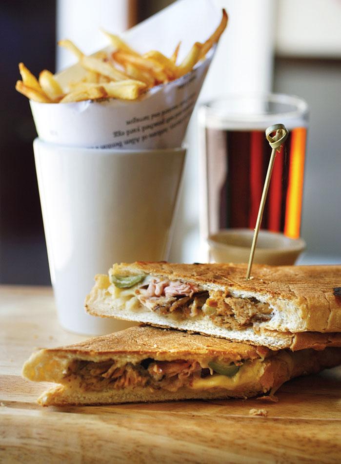 The Cochon de Lait Pressed Sandwich at Luke is a Cuban sandwich with a John Besh touch. (photo via foodarts.com)