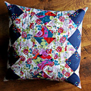 The Garden Gate Pillow is a beautiful, quilted pillow that's sure to brighten up your room's decor. Maureen Cracknell Made shares the tutorial. -Sewtorial