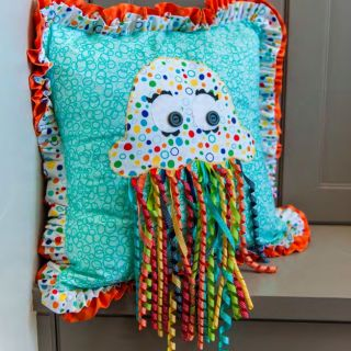 This Jellyfish pillow by Quilty Crate will give your little one something that' not only fun to look at, but has great textures for little exploring hands - Sewtorial