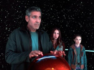 """This photo released by Disney shows, from left, George Clooney, as Frank Walker, Britt Robertson as Casey, and Raffey Cassidy as Athena, in a scene from Disney's """"Tomorrowland."""" The movie releases in U.S. theaters on May 22, 2015. (Film Frame/Disney via AP)"""